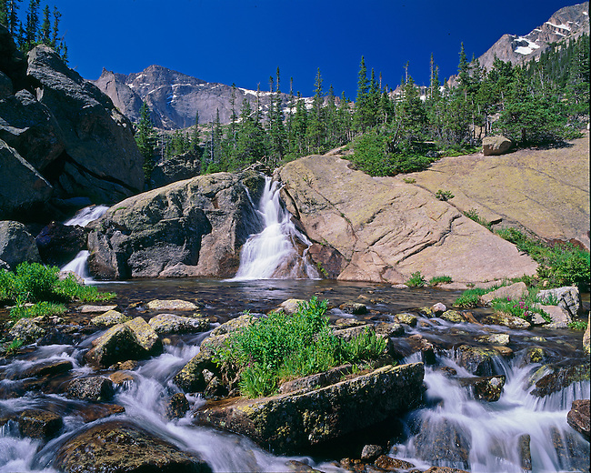 Summer morning along the waterfalls of Glacier Creek beneath Chiefs Head Peak, Rocky Mountain National Park, CO