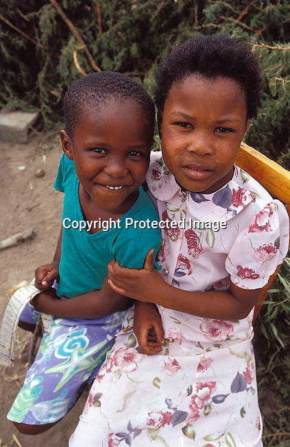 PPCHILD50395.People. Children. 2 Black girls (children) in the Eastern Cape. Sitting and looking straight into the camera.  .©Per-Anders Pettersson / iAfrika Photos