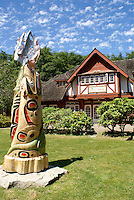 Bowen Island Public Library in the Old General Store in Snug Cove, Bowen Island, British Columbia, Canada. The woodcarving in front of the library is entitled Embracing the Flame. It commemorates the passing of the 2010 passing of the Olympic Flame though Bowen Island.