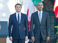 United States President Barack Obama, right, and Prime Minister Matteo Renzi of Italy, left, listen to their nation's National Anthems during an Official Arrival Ceremony in the Prime Minister's honor on the South Lawn of the the White House in Washington, DC on Tuesday, October 18, 2016. <br /> Credit: Ron Sachs / CNP /MediaPunch
