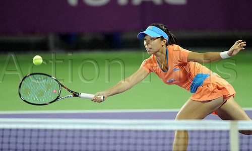 15 02 2012  Doha, Qatar.  Zheng Jie of China Hits A Return during her 1st Round womens single match.