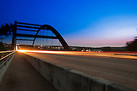 Car lights leave streaks as the pass through the 360 Pennybacker bridge in Austin, Texas