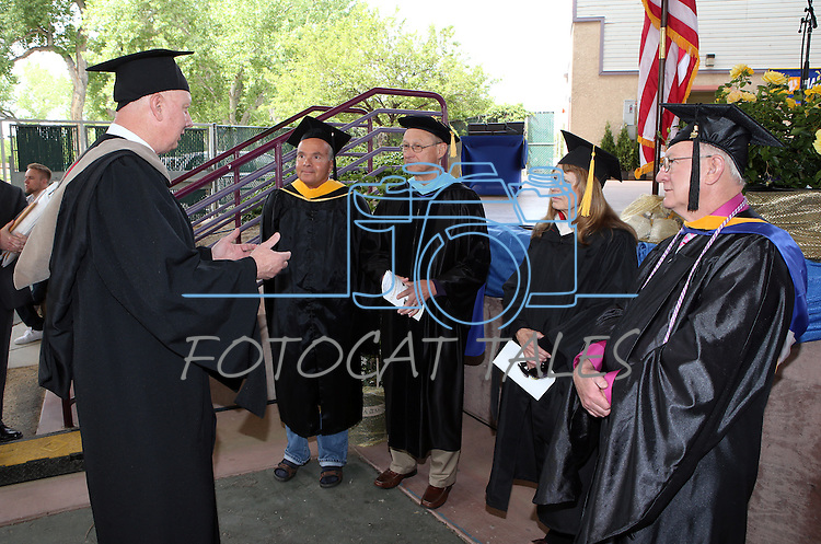 Interim President Chester Burton talks with Faculty Emeriti recipients, from left, Mike Sady, Mike Hardie, Sharon Tetly and Mike Malay before the Western Nevada College commencement at the Pony Express Pavilion, in Carson City, Nev., on Monday, May 19, 2014. <br /> Photo by Cathleen Allison/Nevada Photo Source