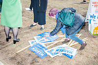 Campaign signs are seen on the ground after Democratic presidential candidate and Massachusetts senator Elizabeth Warren held a small rally outside Graham & Parks School after the candidate voted in the Massachusetts primary as part of Super Tuesday voting in Cambridge, Massachusetts, on Tue., March 3, 2020. The polling place is just a few blocks from Warren's residence. Polls show Warren and Vermont senator Bernie Sanders in a near tie in the Massachusetts Democratic party primary.