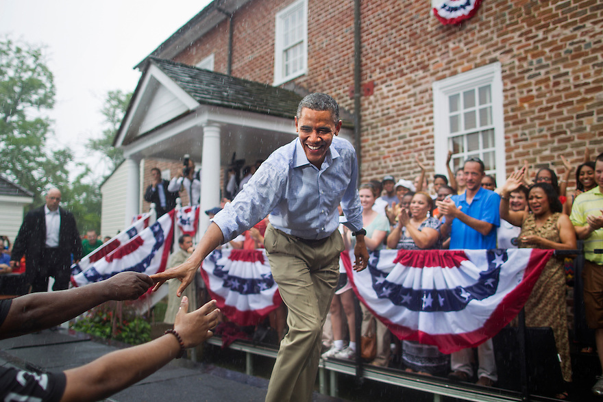 U.S. President Barack Obama arrives for a campaign rally in the rain at Walkerton Tavern in Glen Allen, Virginia.