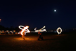 January 27, 2008; Santa Cruz, CA, USA; Fire artists perform at night at Lighthouse Field State Beach in Santa Cruz, CA. Photo by: Phillip Carter