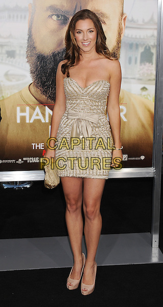 "CARLY CRAIG.""The Hangover Part II"" Los Angeles Premiere held at Grauman's Chinese Theatre, Hollywood, California, USA, 19th May 2011..2 full length dress bow strapless gold stripe clutch bag.CAP/ROT/TM.©Tony Michaels/Roth Stock/Capital Pictures"