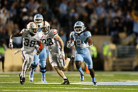 CHAPEL HILL, NC - NOVEMBER 02: Michael Carter #8 of the University of North Carolina is chased by Jaylon Baker #39 of the University of Virginia during a game between University of Virginia and University of North Carolina at Kenan Memorial Stadium on November 02, 2019 in Chapel Hill, North Carolina.