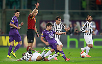 Calcio, ritorno degli ottavi di finale di Europa League: Fiorentina vs Juventus. Firenze, stadio Artemio Franchi, 20 marzo 2014. <br /> Fiorentina midfielder David Pizarro, of Chile, third from right, is challenged by Juventus forward Carlos Tevez, of Argentina, second from right, past Juventus midfielder Arturo Vidal, of Chile, bottom, as referee Howard Webb, of Britain, gestures, during the Europa League round of 16 second leg football match between Fiorentina and Juventus at Florence's Artemio Franchi stadium, 20 March 2014. At left, Fiorentina forward Mario Gomez, of Germany, and at right, Juventus midfielder Andrea Pirlo are seen. Juventus won 1-0 to advance to the quarter-finals.<br /> UPDATE IMAGES PRESS/Isabella Bonotto