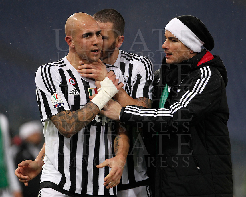 Calcio, quarti di finale di Coppa Italia: Lazio vs Juventus. Roma, stadio Olimpico, 20 gennaio 2016.<br /> From left, Juventus's Simone Zaza, Leonardo Bonucci and Simone Padoin celebrate at the end of the Italian Cup quarter final football match between Lazio and Juventus at Rome's Olympic stadium, 20 January 2016. Juventus won 1-0.<br /> UPDATE IMAGES PRESS/Isabella Bonotto