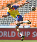 Robin van Persie of the Netherlands kicks the ball during a soccer training session in Soccer City stadium Johannesburg June 13, 2010.   REUTERS/Michael Kooren (SOUTH AFRICA) ...