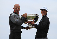 Thorbjorn Olesen (DEN) and Kelly Slater (AM) on the Swilcan Bridge after winning the 2015 Alfred Dunhill Links Championship at the Old Course in St. Andrews in Scotland on 4/10/15.<br />