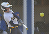 Francesca Cuttitta #11, Massapequa first baseman, connects for her second two-run homer of the afternoon in the top of the seventh inning of a Nassau County AA-1 varsity softball game against host East Meadow on Wednesday, April 11, 2018. Massapequa won by a score of 8-4.