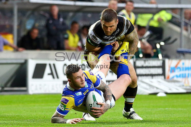 PICTURE BY ALEX WHITEHEAD/SWPIX.COM - Rugby League - Super League - Hull FC vs Leeds Rhinos - KC Stadium, Hull, England - 31/05/13 - Leeds' Zak Hardaker is tackled by Hull FC's Kirk Yeaman.