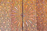 Fes, Morocco.  Medersa Bou Inania.  Carved Wooden Geometric  Decoration in Door Panel.