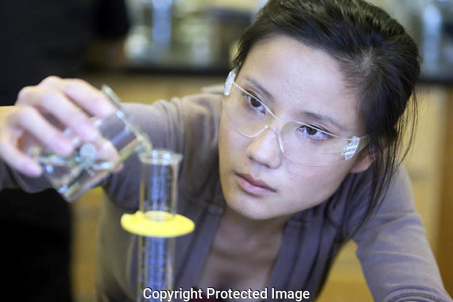 A University of Wisconsin-Manitowoc student measures a liquid in a chemistry lab.