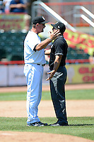 Erie Seawolves manager Chris Cron #44 argues a call with umpire Chris Gonzalez during a game against the New Britain Rock Cats on June 20, 2013 at Jerry Uht Park in Erie, Pennsylvania.  New Britain defeated Erie 2-0.  (Mike Janes/Four Seam Images)