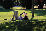 Woman reading in the park, Milan, Italy. .  John offers private photo tours in Denver, Boulder and throughout Colorado, USA.  Year-round. .  John offers private photo tours in Denver, Boulder and throughout Colorado. Year-round.