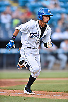 Asheville Tourists right fielder Manny Melendez (19) runs to first base during a game against the Augusta GreenJackets at McCormick Field on July 16, 2017 in Asheville, North Carolina. The Tourists defeated the GreenJackets 12-3. (Tony Farlow/Four Seam Images)
