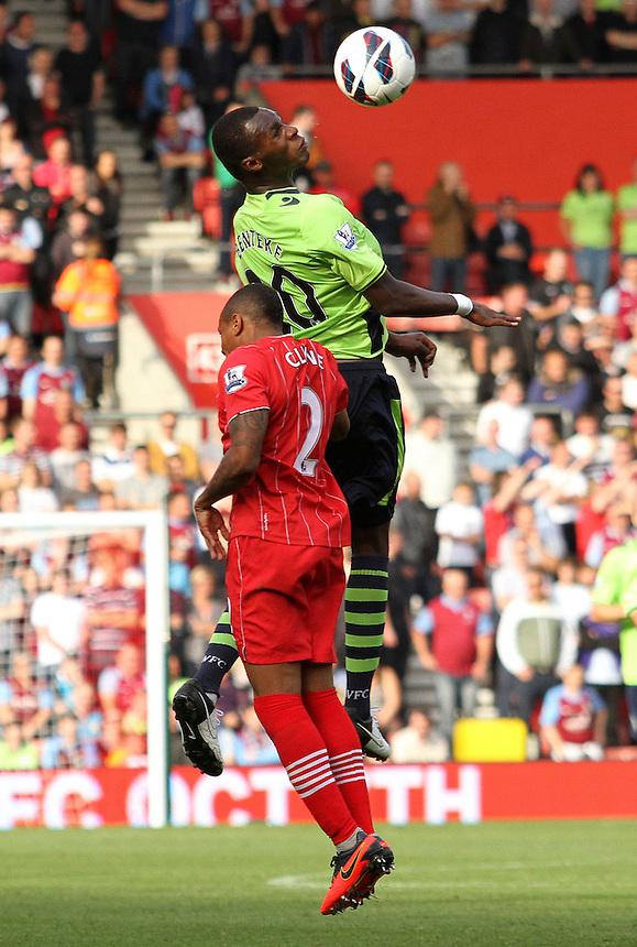 Aston Villa's Christian Benteke heads clear of Southampton's Nathaniel Clyne...Football - Barclays Premiership - Southampton v Aston Villa - Saturday 22nd September 2012 - St Mary's Stadium - Southampton..