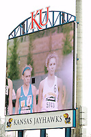 Francis Howell's Maddi Leigh (left) and St. Teresa's Ann Cambell are shown on the video board just before the start of the girls 3200-meters at the 2015 Kansas Relays.