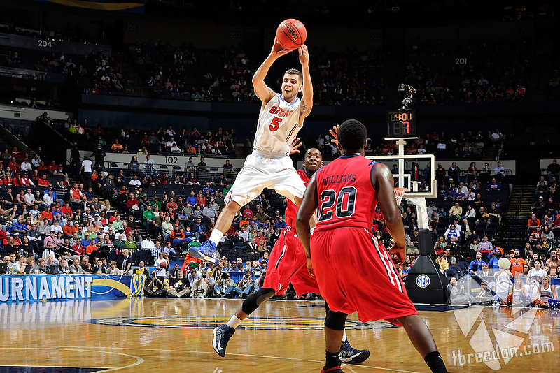NASHVILLE, TN - MARCH 17:  Scottie Wilbekin #5 of the Florida Gators jumps to make a pass against the Ole Miss Rebels during the SEC Baskebtall Tournament Championship Game at Bridgestone Arena on March 17, 2013 in Nashville, Tennessee.  (Photo by Frederick Breedon/Getty Images)