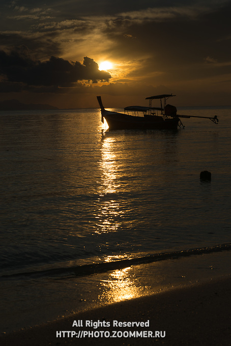 Silhouette of a longtail boat near the beach during sunrise, Koh Lipe, Thailand