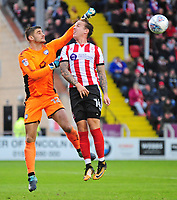 Chesterfield's Joe Anyon punches clear under pressure from Lincoln City's Jordan Maguire-Drew<br /> <br /> Photographer Andrew Vaughan/CameraSport<br /> <br /> The EFL Sky Bet League Two - Lincoln City v Chesterfield - Saturday 7th October 2017 - Sincil Bank - Lincoln<br /> <br /> World Copyright &copy; 2017 CameraSport. All rights reserved. 43 Linden Ave. Countesthorpe. Leicester. England. LE8 5PG - Tel: +44 (0) 116 277 4147 - admin@camerasport.com - www.camerasport.com