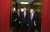 United States Secretary of Defense Donald H. Rumsfeld (right) escorts United States President George W. Bush and United States Vice President Dick Cheney to their meeting in the Pentagon on January 13, 2005.  Bush and Cheney were briefed on the tsunami relief efforts and the global war on terrorism.                            <br /> Mandatory Credit: James Bowman / DoD via CNP