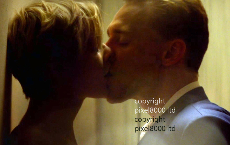 Pic shows: Earlier in the show even gay character Corky played by Tom Hollander could not resist a grab of Tom Hiddleston's genitals and bum during a fight scene in a restaurant.<br /> <br /> Steamy sex scene on the BBC last night as The Night Manager continued <br /> with Tom Hiddleston hearthrob bared his bum to grind actress Elizabeth Debicki against the wall with rhythm and gusto.<br /> <br /> <br /> <br /> Picture BBC supplied by Pixel8000  07917221968