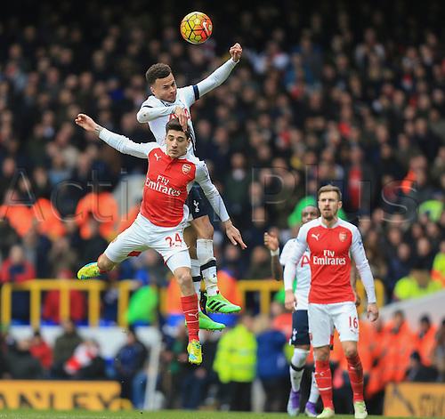 05.03.2016. White Hart Lane, London, England. Barclays Premier League. Tottenham Hotspur versus Arsenal. Dele Alli of Tottenham Hotspur  gets up to win the header from Héctor Bellerín of Arsenal.