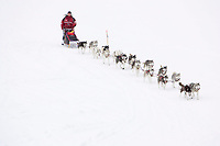 Karen Ramstead and her registered Siberian Husky team runs up the bank of the Kuskokwim river shortly before McGrath on Wednesday during Iditarod 2008