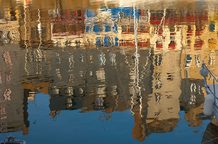 Reflection of harbour buildings and yaughts. Honfleur, Normandy, France.