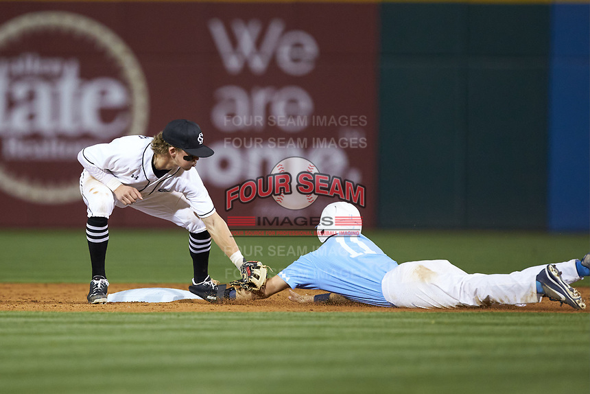 L.T. Tolbert (11) of the South Carolina Gamecocks tags out Cody Roberts (11) of the North Carolina Tar Heels at BB&T BallPark on April 3, 2018 in Charlotte, North Carolina. The Tar Heels defeated the Gamecocks 11-3. (Brian Westerholt/Four Seam Images)