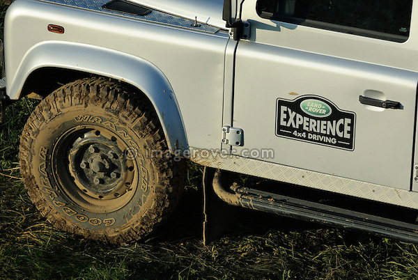 Mud covered silver metallic Land Rover Defender 110 TD5 used by Land Rover Experience for driver training. Europe, Germany, Bad Kissingen. --- No releases available. Automotive trademarks are the property of the trademark holder, authorization may be needed for some uses.