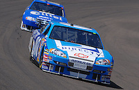 Apr 19, 2007; Avondale, AZ, USA; Nascar Nextel Cup Series driver Clint Bowyer (07) leads Ryan Newman (12) during practice for the Subway Fresh Fit 500 at Phoenix International Raceway. Mandatory Credit: Mark J. Rebilas