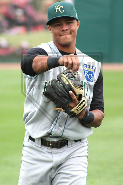 Appleton - JULY 2011: Yowill Espinal (7) of the Kane County Cougars, Class-A affiliate of the Kansas City Royals during a game on July 7, 2011 at Time Warner Cable Field at Fox Cities Stadium in Appleton, Wisconsin. (Photo by Brad Krause).....