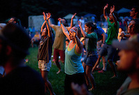 Participants in the Wild Goose Festival dance to the music of Ryan Sollee/Damion Suomi & The Minor Prophets on June 22, 2012, the second night of the four-day festival, held at the Shakori Hills Community Arts Center in Pittsboro, NC.