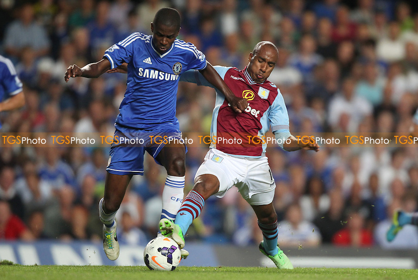 Fabian Delph of Aston Villa puts in a challenge on Ramires of Chelsea - Chelsea vs Aston Villa - Barclays Premier League Football at Stamford Bridge, Fulham Road, London - 21/08/13 - MANDATORY CREDIT: Simon Roe/TGSPHOTO - Self billing applies where appropriate - 0845 094 6026 - contact@tgsphoto.co.uk - NO UNPAID USE