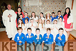 M/s O'Brien's  class from Killocrim NS, Listowel who received their 1st communion from Canon Declan O'Connor at St. Mary's Church, Listowel on Saturday last pictured with [principal Mrs O'Driscoll.
