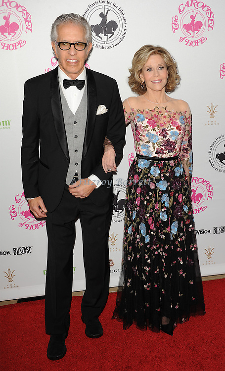 Jane Fonda and Richard Perry arriving at The 2016 Carousel Of Hope Ball held at the Beverly Hilton Hotel Beverly Hills California October 8, 2016.