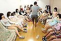 July 5, 2010 - Tokyo Japan - Ta-bo, an avid Love Doll collector, walks in a room which is filled with seated Love Dolls in Tokyo, Japan, on July 5, 2010. The 50-year-old Japanese engineer who rents a special three-bedroom apartment for his Love Dolls, says he owns more than one hundred, which is, to his mind, the world's largest collection of its kind.