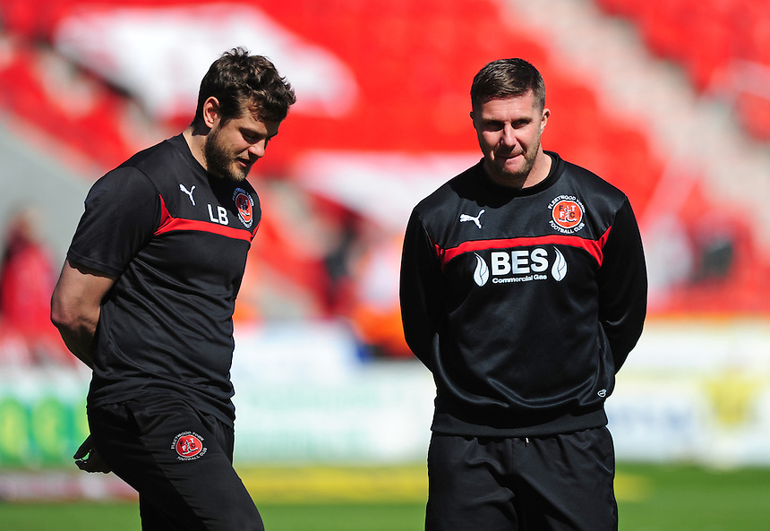 Fleetwood Town's Physiotherapist Luke Bussey, left, and Fleetwood Town's Assistant Manager Chris Lucketti during the pre-match warm-up <br /> <br /> Photographer Chris Vaughan/CameraSport<br /> <br /> Football - The Football League Sky Bet League One - Doncaster Rovers v Fleetwood Town - Saturday 18th April 2015 - Keepmoat Stadium - Doncaster<br /> <br /> &copy; CameraSport - 43 Linden Ave. Countesthorpe. Leicester. England. LE8 5PG - Tel: +44 (0) 116 277 4147 - admin@camerasport.com - www.camerasport.com