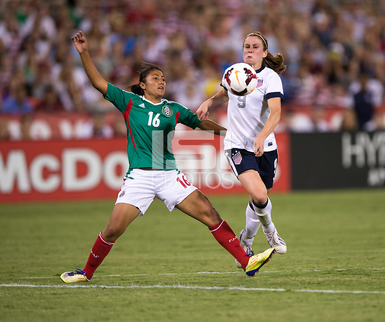 Heather O'Reilly () of the USWNT controls the ball in front of Stephany Mayor (16) of Mexico during an international friendly at RFK Stadium in Washington, DC.  The USWNT defeated Mexico, 7-0.