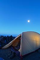 Tent in an alpine camp below full moon, Mount Adams, Yakima County, Cascade  Mountains, Washington, USA