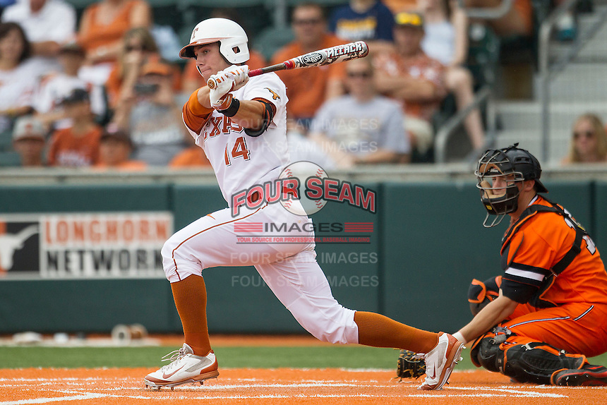 Texas Longhorns outfielder Ben Johnson #14 follows through on his swing during the NCAA baseball game against the Oklahoma State Cowboys on April 26, 2014 at UFCU Disch–Falk Field in Austin, Texas. The Cowboys defeated the Longhorns 2-1. (Andrew Woolley/Four Seam Images)