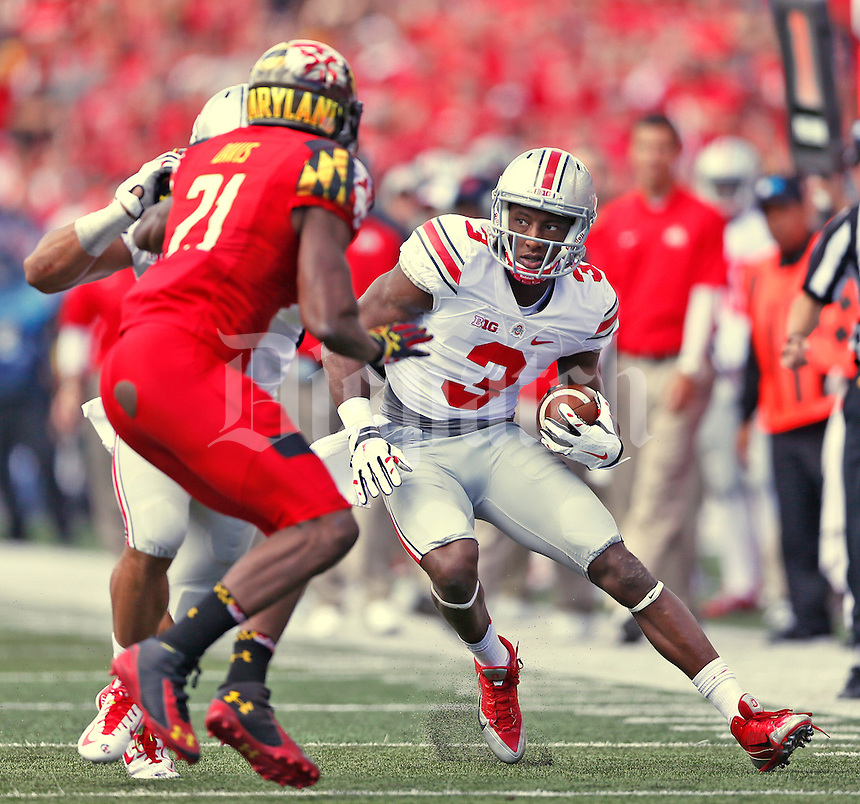 Ohio State Buckeyes wide receiver Michael Thomas (3) looks for more yardage after a reception in the first half  at Byrd Stadium on October 4, 2014.  (Chris Russell/Dispatch Photo)