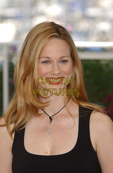 "LAURA LINNEY.""Mystic River"" Photocall.Cannes Film Festival 2003.www.capitalpictures.com.sales@capitalpictures.com.©Capital Pictures.star pendant, pale skin"