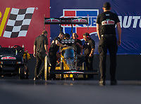 Feb 3, 2017; Chandler, AZ, USA; Crew members prepare to fire up the dragster of NHRA top fuel driver Leah Pritchett during Nitro Spring Training preseason testing at Wild Horse Pass Motorsports Park. Mandatory Credit: Mark J. Rebilas-USA TODAY Sports