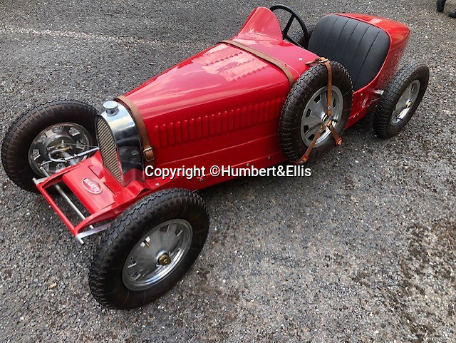 BNPS.co.uk (01202 558833)<br /> Pic: Humbert&Ellis/BNPS<br /> <br /> An Ettore Bugatti from the 1980's, est. £6,500.<br /> <br /> £200,000 of pedal power...<br /> <br /> A remarkable single owner collection of over 85 vintage toy cars has emerged for sale for £200,000.<br /> <br /> The fleet of rare pedal cars which were acquired over half a century form what is thought to be the biggest private collection of its kind in the world.<br /> <br /> It includes child car models of Rolls Royces, Bugattis and Bentleys, as well as a quirky amphibian car. <br /> <br /> The collection has been consigned for sale with Humbert & Ellis Auctioneers by a retired businessman in his 80s.<br /> <br /> He travelled all over the world to get his hands on the cars, and built a barn next to his Devon home to display them in.